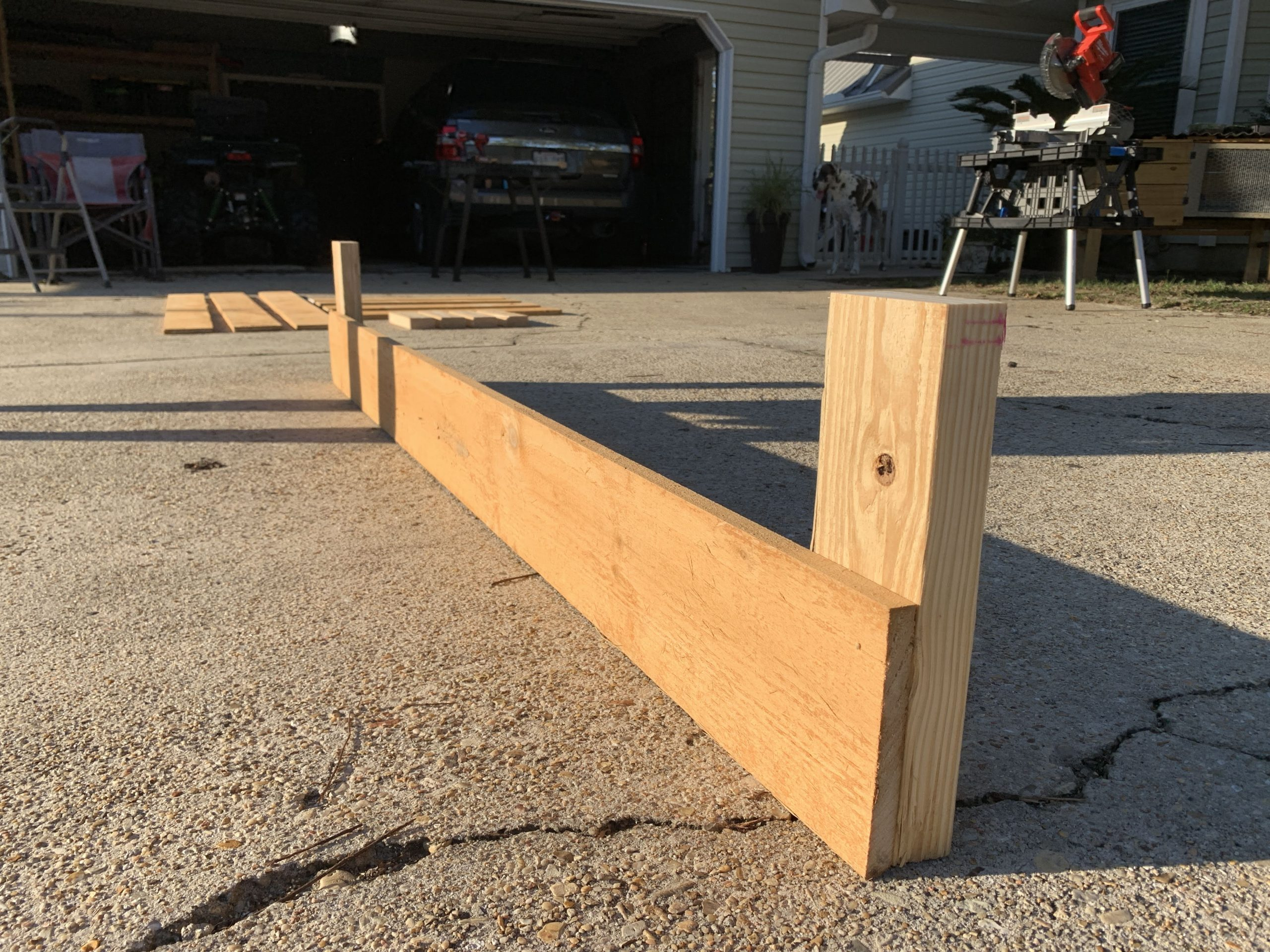 2x4s attached to fence picket